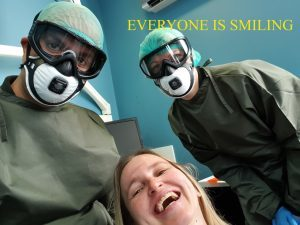 Smiling behind PPE